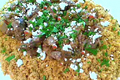 Greek Style Braised Lamb Over North African Style Eggplant And Couscous